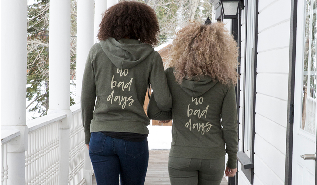 "Two women walking in ""No Bad Days"" hoodies from Tahoe University"
