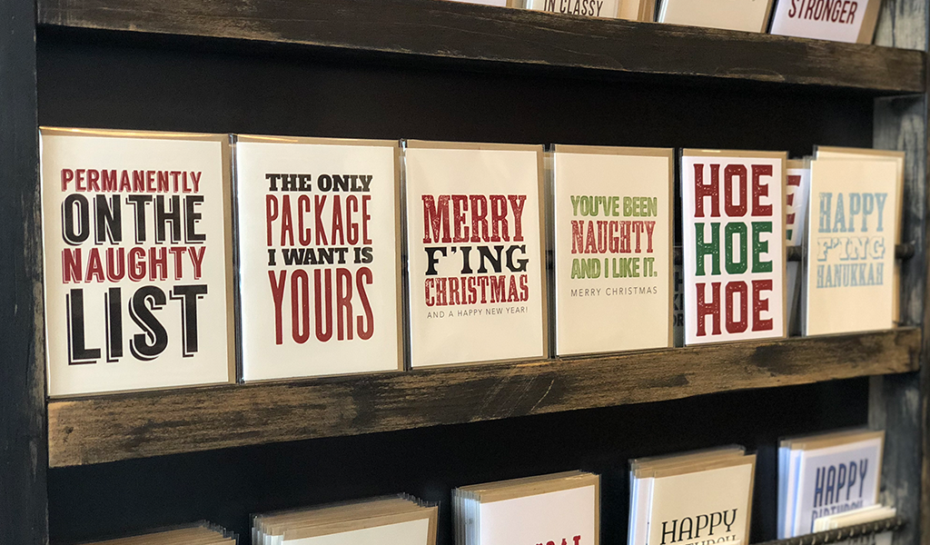 Naughty typography Christmas and holiday cards at Tahoe University boutique shop