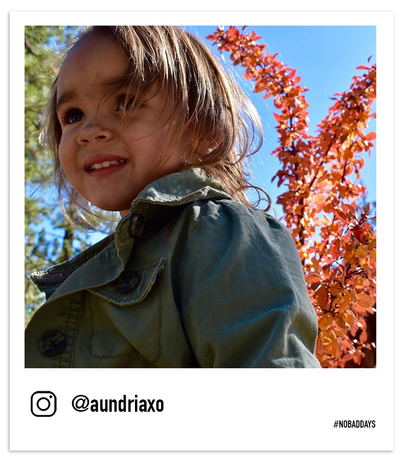 Young child smiles at the red fall leaves by @aundriaxo