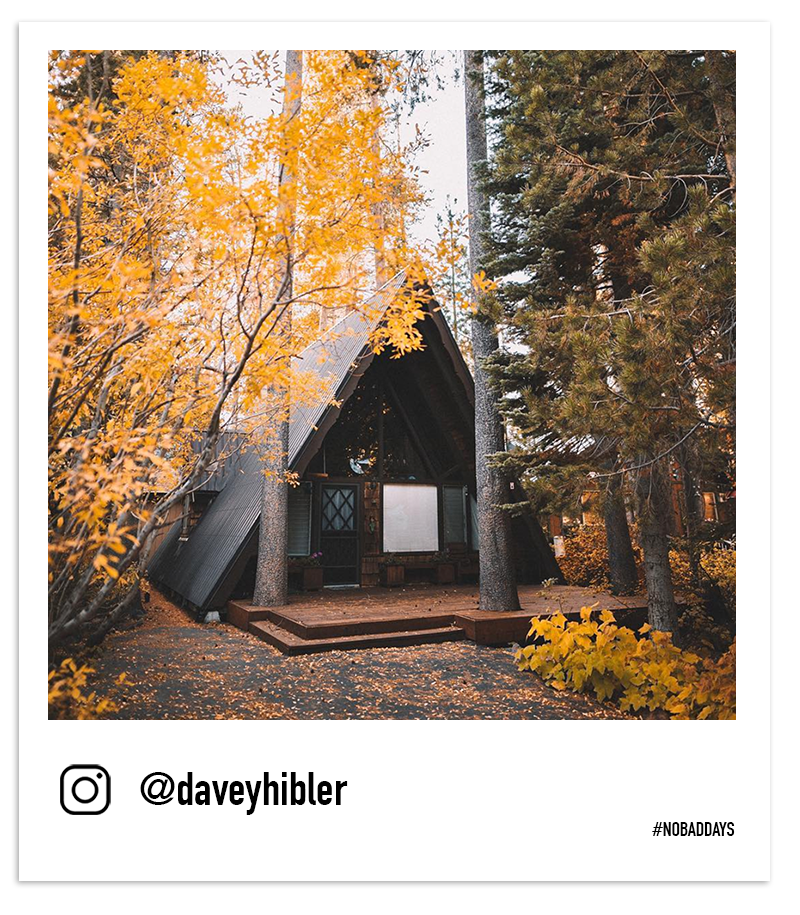 A-Frame cabin in Truckee nestled among yellow and orange aspen trees by @daveyhibler