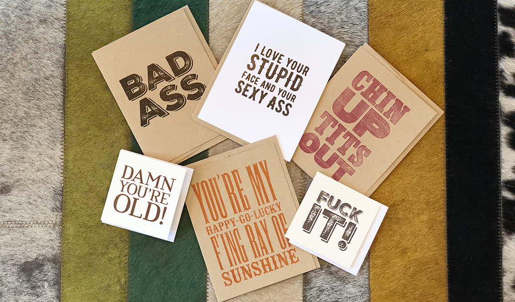 Assorted gift cards with swear words at Tahoe University