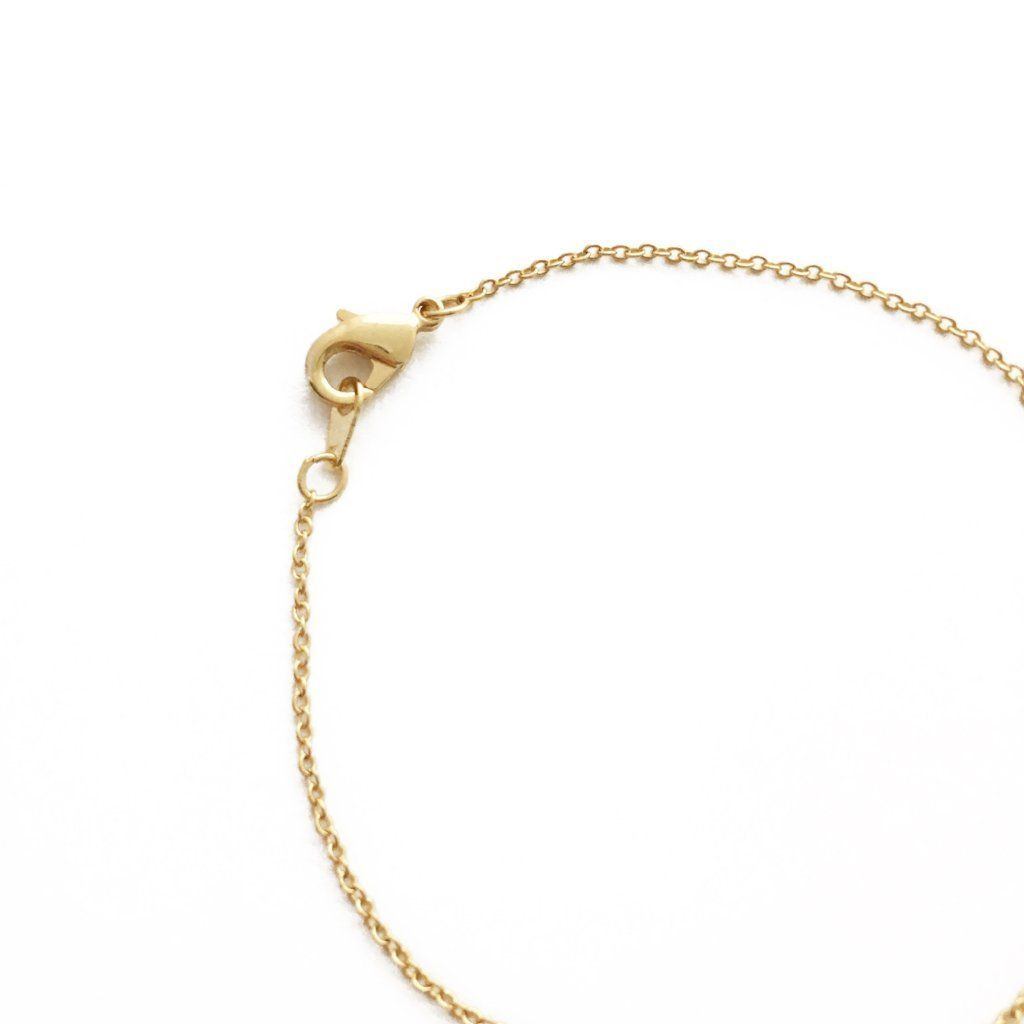 whisper seasonal whispers gold matte bracelet clear