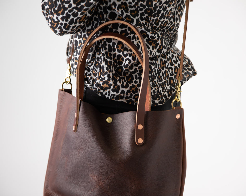 Brown Kodiak tote with crossbody strap