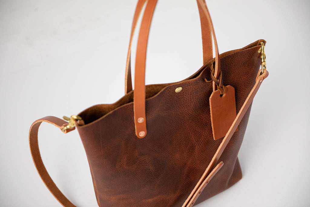 Tan Kodiak leather tote bag with crossbody strap