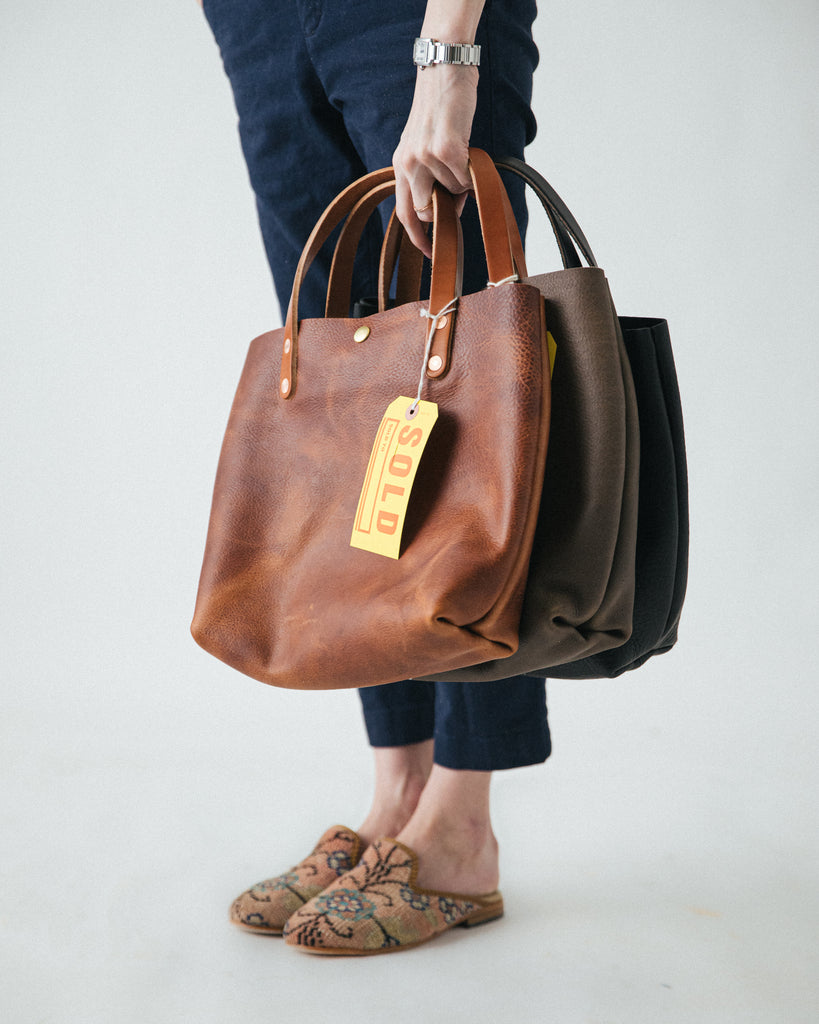 Leather mini tote bags at KMM & Co.