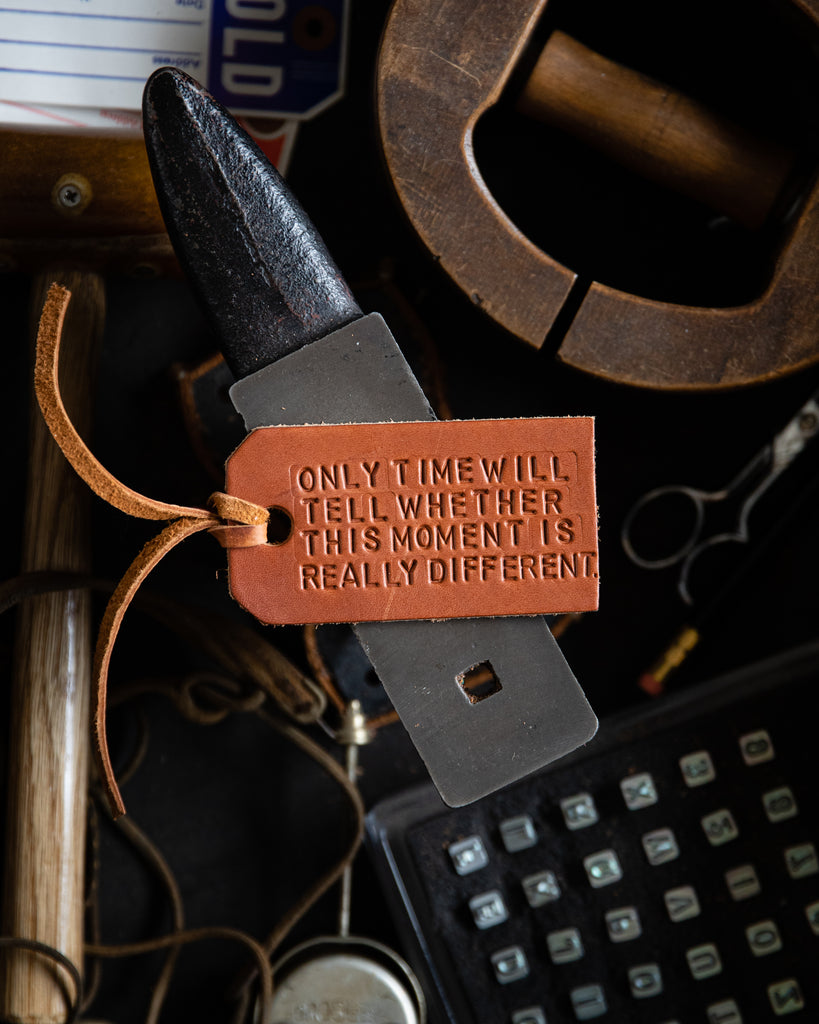 Leather tag with quote by Tressie McMillan Cottom