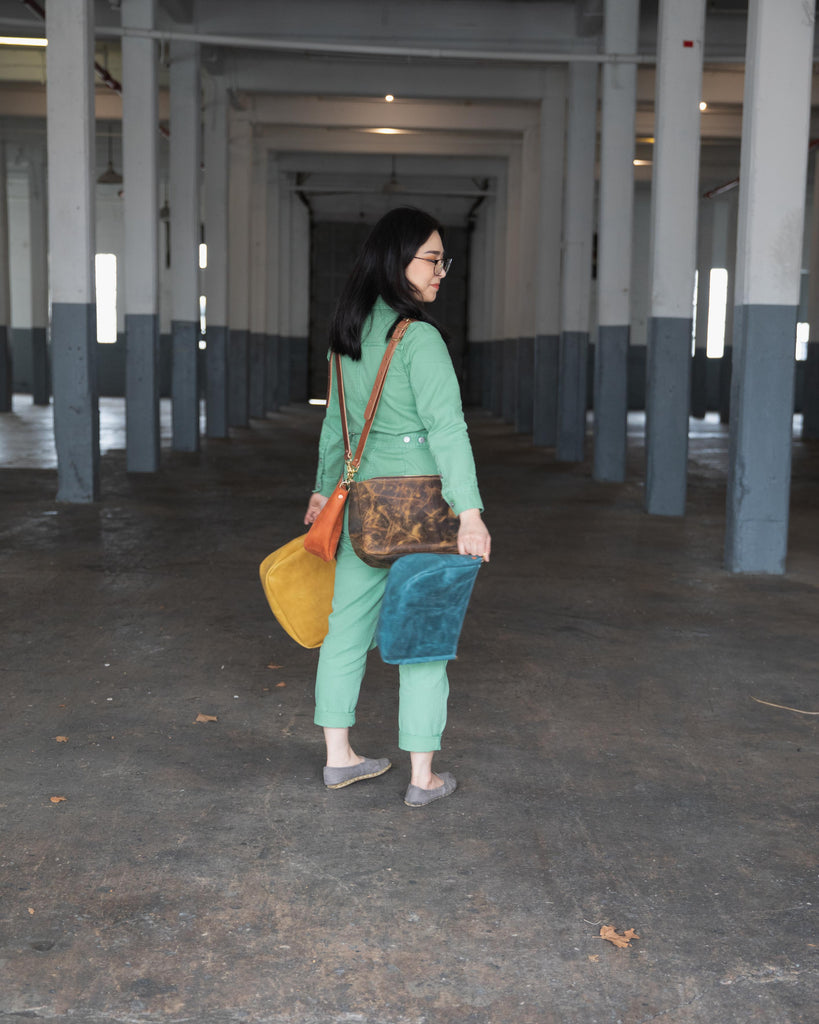 Bright leather crossbody bags by KMM & Co.