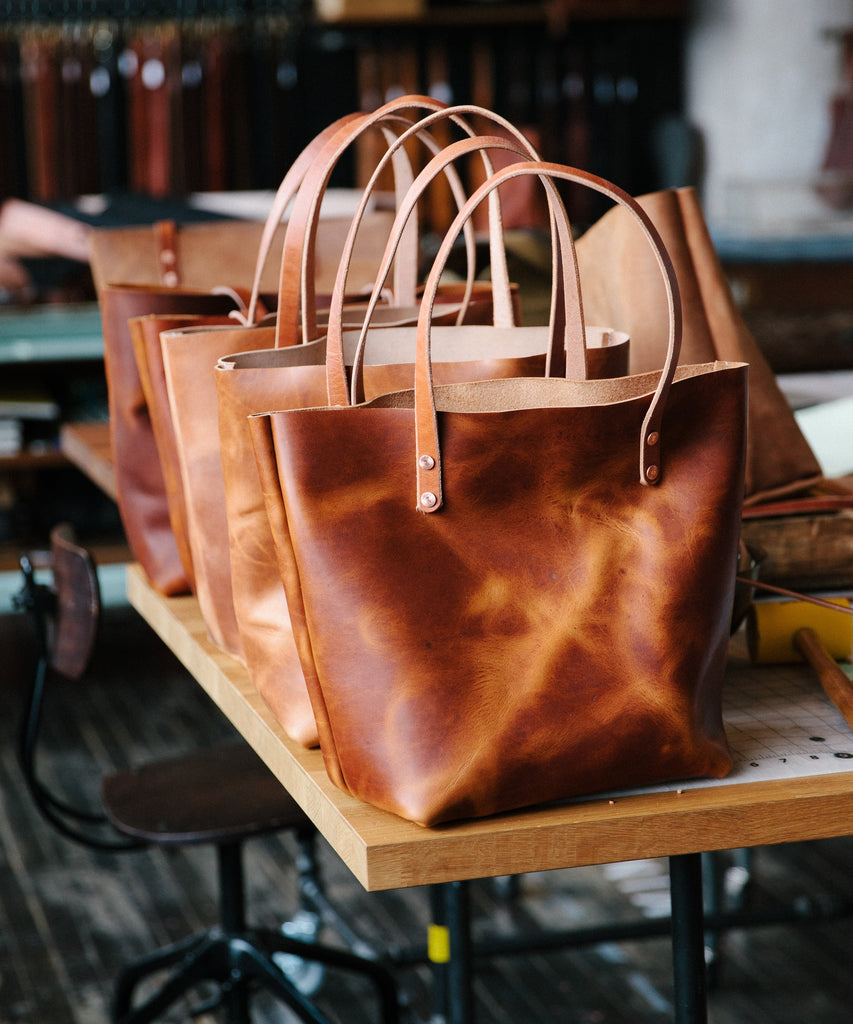Leather tote bags at KMM & Co.