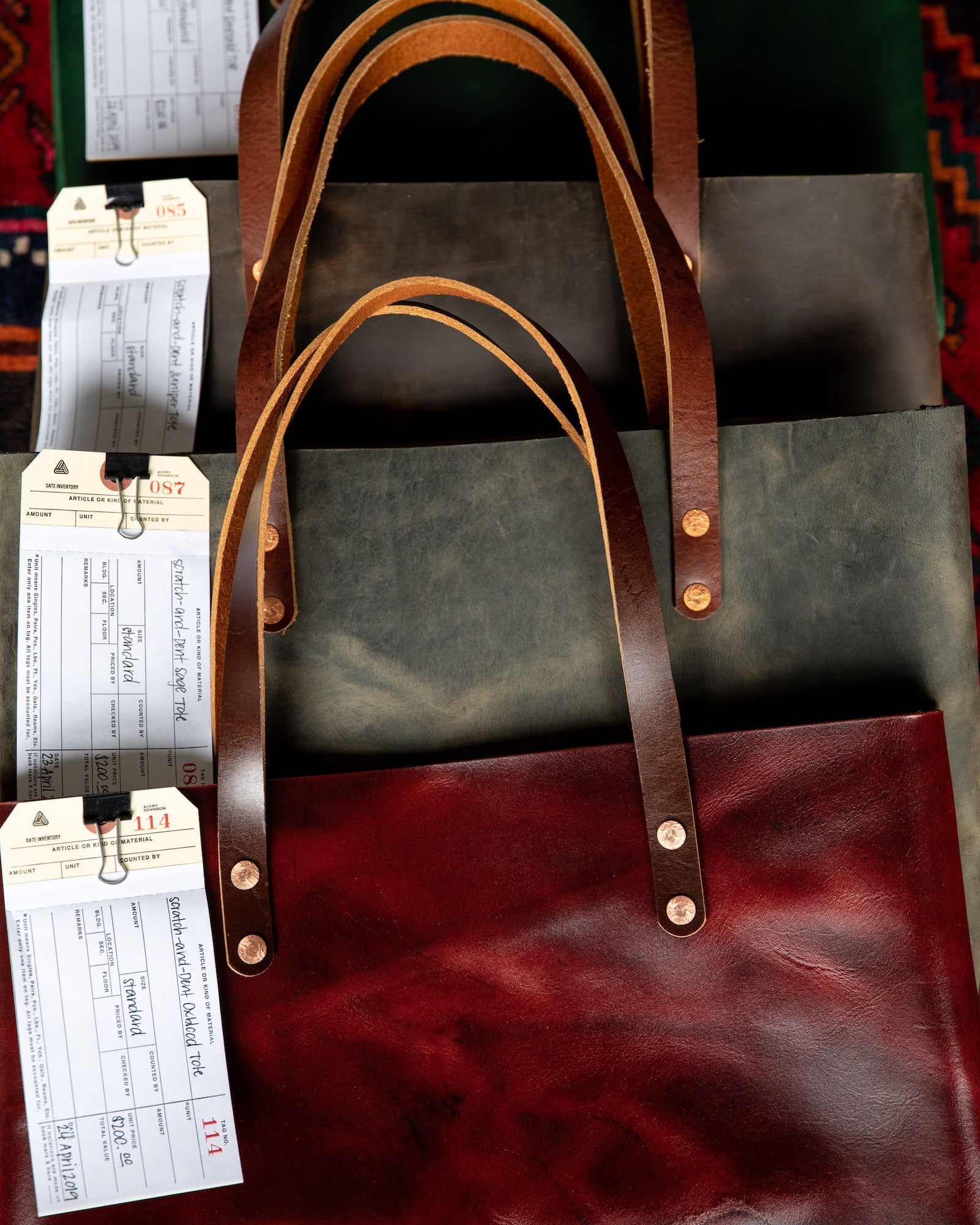 Scratch-and-dent leather tote bags