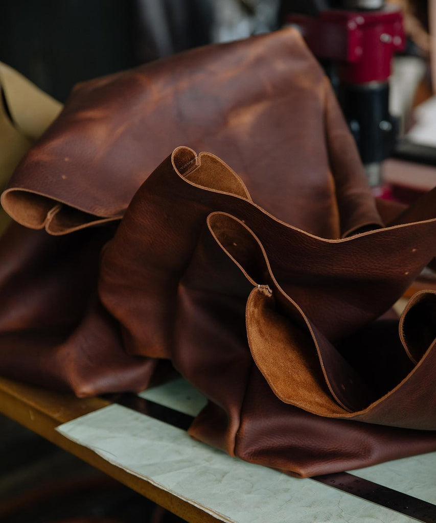 Tan Kodiak leather totes turned right-side out