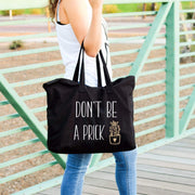 dont be a prick black tote with cactus