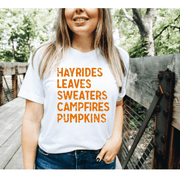 Fall Favorites Tee - Hayrides Leaves Sweaters Campfires Pumpkins - 721 Done