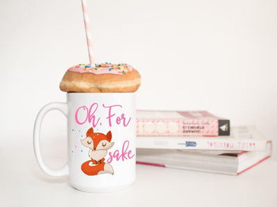 Oh, for fox sake in pink text featuring a orange and tan fox with sassy folded arms and eyes closed on a 15 oz ceramic mug with a donut on top and books in background