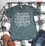 this is my christmas movie watching tee in white lettering on a green marble vneck t-shirt close up