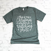 this is my christmas movie watching tee in white lettering on a green marble vneck t-shirt