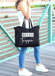 Road trippin' white words on large black tote bag alternate view showing in use