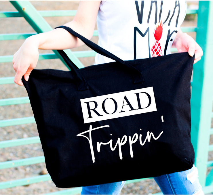 Road trippin' white words on large black tote bag close up view