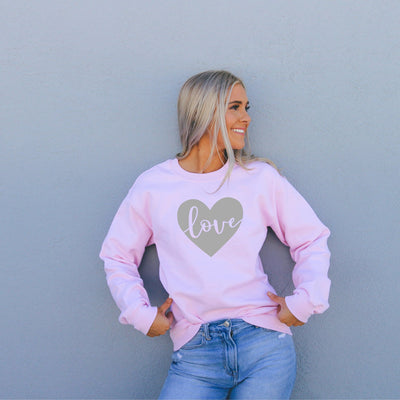 Love in grey heart on a pink crewneck sweatshirt