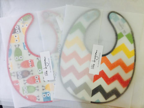 Little Dragon by Lauren Unlimited custom made owl and rainbow chevron laminated cotton baby bibs