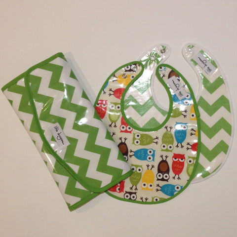 Little Dragon by Lauren Unlimited custom made laminated cotton owl and chevron bibs and a green chevron change mat clutch