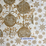 Lauren Unlimited Reversible Christmas Table Runner in Cream with Metallic Gold Stars, Snowflakes and Metallic Gold Baubles close up image
