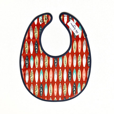 Little Dragon by Lauren Unlimited red and navy blue surf board laminated cotton baby bib