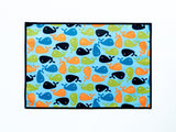 Little Dragon by Lauren Unlimited aqua blue, navy, green and orange whale laminated cotton placemat
