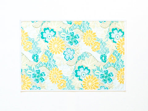 Lauren Unlimited teal blue, yellow, grey and white floral seascape laminated cotton placemat