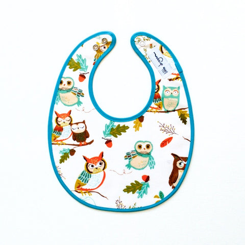 Little Dragon by Lauren Unlimited aqua and white owl laminated cotton baby bib