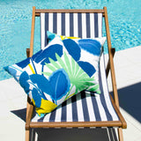 Lauren Unlimited Costa Rica Blue, Yellow, Green and White Indoor/Outdoor Cushion Cover on display in a lounge chair beside the pool