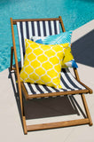 Lauren Unlimited Yellow & White Geometric Trellis Indoor/Outdoor Cushion Cover on display with the Costa Rica cushion beside a gleaming pool