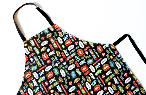 Lauren Unlimited Black, green, red and blue superhero comic Laminated Cotton Adult Apron