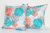 A pair of Lauren Unlimited Coral, Turquoise, Grey, Charcoal and White Blooms Indoor/Outdoor Cushion Cover