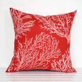 Outdoor cushion with white coral on a red background