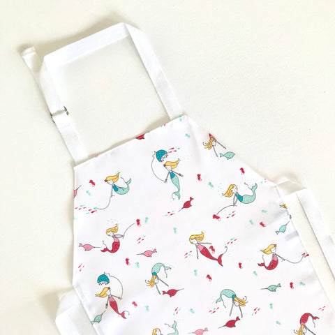 Mermaid pink, aqua and white laminated cotton children's apron by Little Dragon by Lauren Unlimited