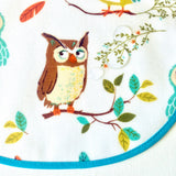 Little Dragon by Lauren Unlimited aqua and white owl laminated cotton baby bib close up showing water droplets