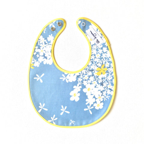 Little Dragon by Lauren Unlimited blue, white and lemon yellow dandelion floral laminated cotton baby bib
