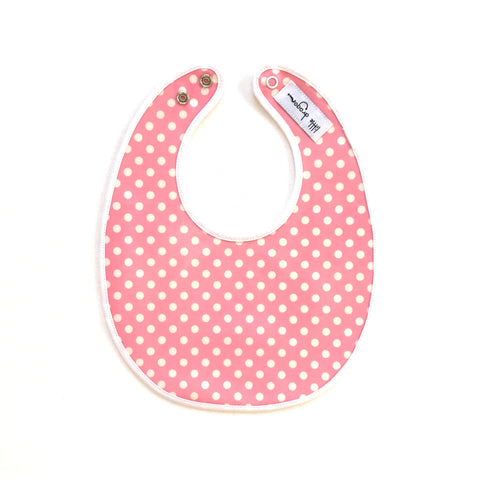 Little Dragon by Lauren Unlimited pink and white polka dot laminated cotton baby bib