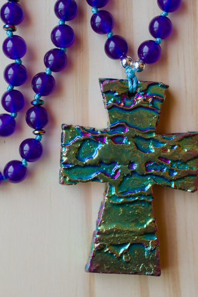 "28"" Long Hand Knotted Rainbow Titanium Coated Cross with Amethyst Purple Glass Beads"