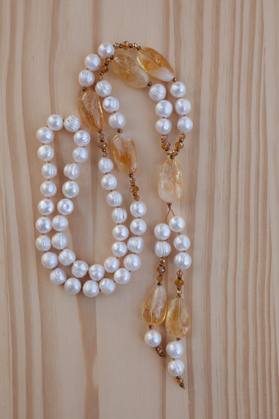 Long hand knotted white freshwater pearl necklace with citrine nuggets and crystal beads
