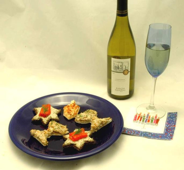 Dilled Salmon Canapès on Hanukkah toast cut outs, served with white wine