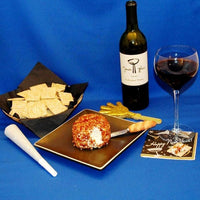 New Year's Garlic Blue Cheese Ball rolled in Bacon with good red wine