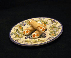 Cannoli filled with White Chocolate Amaretto Mousse, garnished with apricot pieces Summer