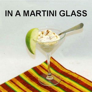 Apple Rum Raisin Mousse in martini glass with cinnamon and apple garnish