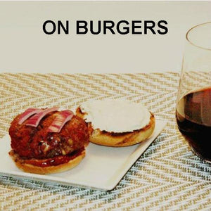Hamburger slider with onions and Bacon Praline Spread, served with red wine