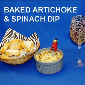 Hot baked Artichoke Spinach Dip on baguette slices, served with white wine