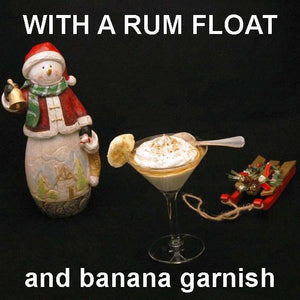Bananas Foster Mousse with rum float and banana garnish in martini glass Christmas