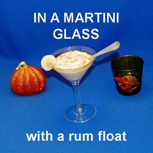 Bananas Foster Mousse with rum float and banana garnish in martini glass Fall