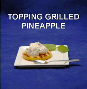 Grilled pineapple ring with Bananas Foster Mousse topping
