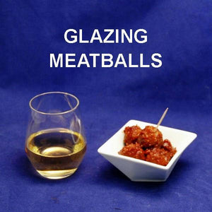 Bloody Mary Spiced Ketchup Glazed Meatballs served with white wine